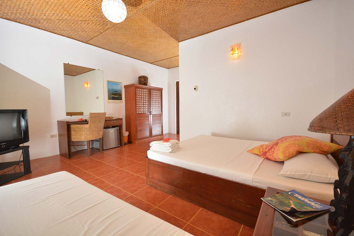 Hibiscus Garden Inn Classic Type Room in Bed View